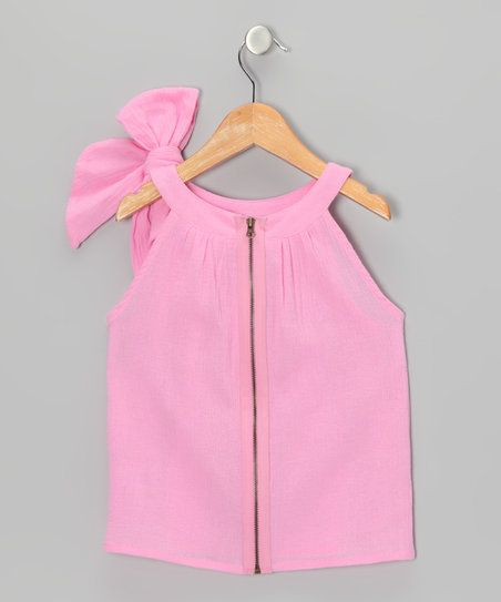 This crinkle sheer top features an easy-on zipper plus a shoulder bow for a look that combines comfortable with adorable. Timeless yet fresh, it's versatile enough to be worn anywhere from the park to a birthday party.