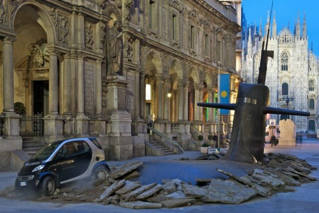 Submarine Rises Up From Beneath City Street