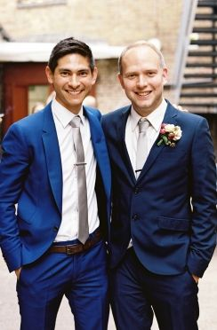 Groom in brighter navy with silver/grey tie. Groomsmen in dark navy with silver/grey tie.