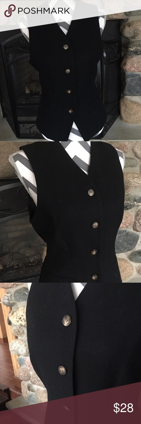 100% wool Land's Ends women's fashion vest Women's black fashion vest, size 4/6 with adjustable back 100% wool and nickel bottoms.  Beautiful and classy vest!!! Lands' End Jackets & Coats Vests