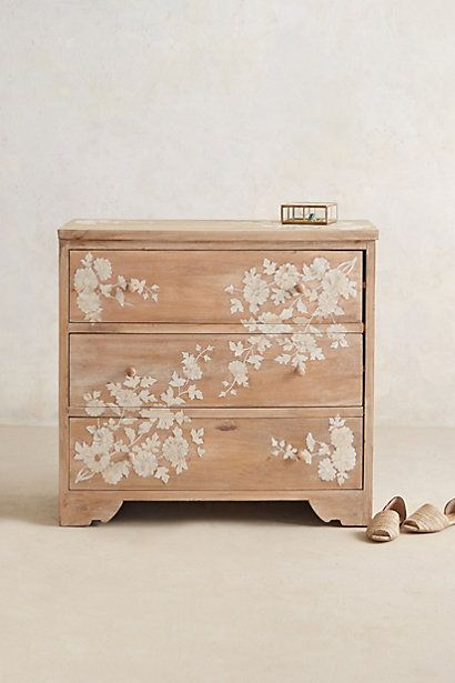 Anthropologie EU Pearl Inlay Dresser: employing a centuries-old decorative technique, this handcarved, three-drawer mango wood dresser is inlaid with luxurious mother of pearl that lends it texture and contrast. Ornamented in neutral white, it's simply striking in both classic and contemporary bedrooms.