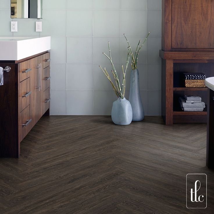 Smoked Oak - 5271 -   Smoked Oak's strong yet classic features makes it the ideal choice for interiors wishing to create a luxurious finish.  This traditional wood plank design lends itself to timeless flooring layouts such as herringbone, which can be further enhance using inlay strips to create a striking design feature.  (Full plank herringbone)