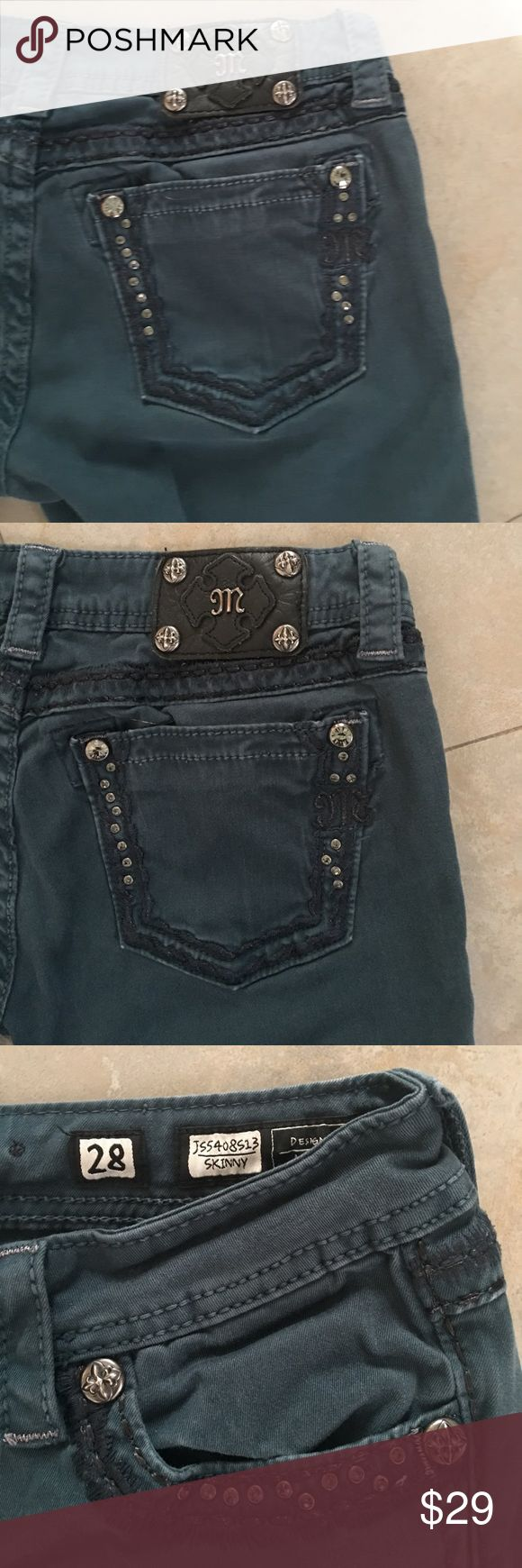 """MISS ME SKINNY JEANS MISS ME SKINNY JEANS.  No Rips, stains or Marks. Color is OK Teal.  Black stitched fringe design on both front pockets, and designs on both Back pockets. Worn but in great condition. Price reflects, Refer to pics.  Questions Welcomed. Size 28 Inseam 32"""" Miss Me Jeans Skinny"""