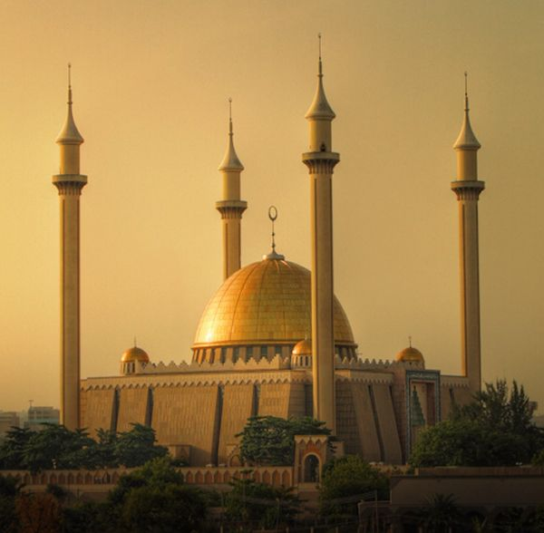 1. The capital of Nigeria is Abuja. Some of the most famous buildings are the National Christian centre, the millenium tower (under construction, and the national mosque, shown in picture. Abuja has low population, a central location, and the ability to expand.