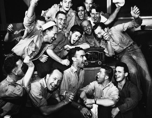 US sailors stationed at Pearl Harbor reacting to the official signing of the surrender by the Japanese, 2 September 1945
