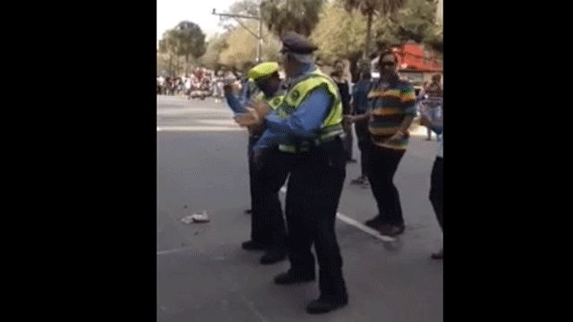 "Keep on dancing, Wobble cop. | This Cop Doing ""The Wobble Dance"" At Mardi Gras Will Restore Your Faith In The Police"