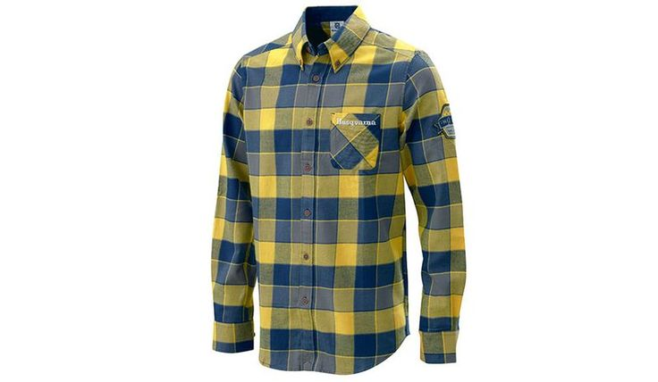 PATHFINDER SHIRT  A comfortable soft flannel shirt with a stylish check design featuring Husqvarna embroidery on the breast pocket and an embroidered emblem on the neck. Cuffs and collar are lined with blue corduroy material and features wooden-look buttons and woven badge on sleeve.