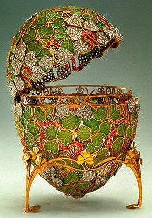 "(1) FABERGE Egg No. 25?__1902.  Imperial ""Clover Leaf ""Egg.  Emperor Nicholas II to Empress Alexandra Feodorovna.  The surprise has been lost but according to archives it is reported to be a four leaf clover with twenty three diamonds, and four miniature portraits of the four daughters of the Emperor: Olga, Tatiana, Maria and Anastasia."