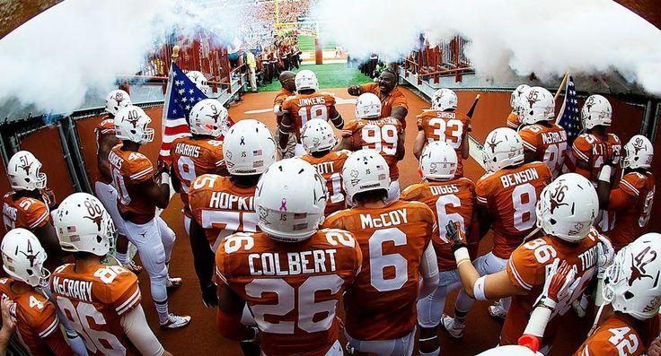 Texas Longhorns football team enters the stadium.