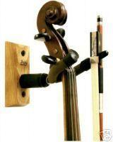 wall mount violin stand I love how it would allow me to keep my violin out! No messing with zippers, clasps, or Velcro just grab and play and it would keep it out of the reach of little ones!!!!