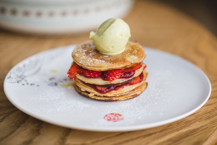Buckwheat-almond-millet pancakes with strawberry sauce, fresh strawberries and homemade green tea ice cream.