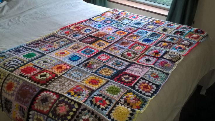 Beautiful crochet granny square cover.  OOAK multicoloured throw. Measures 180cmsx98cms.  Unique bedspread or throw for chair or settee. by Nobodyknitsitbetter on Etsy