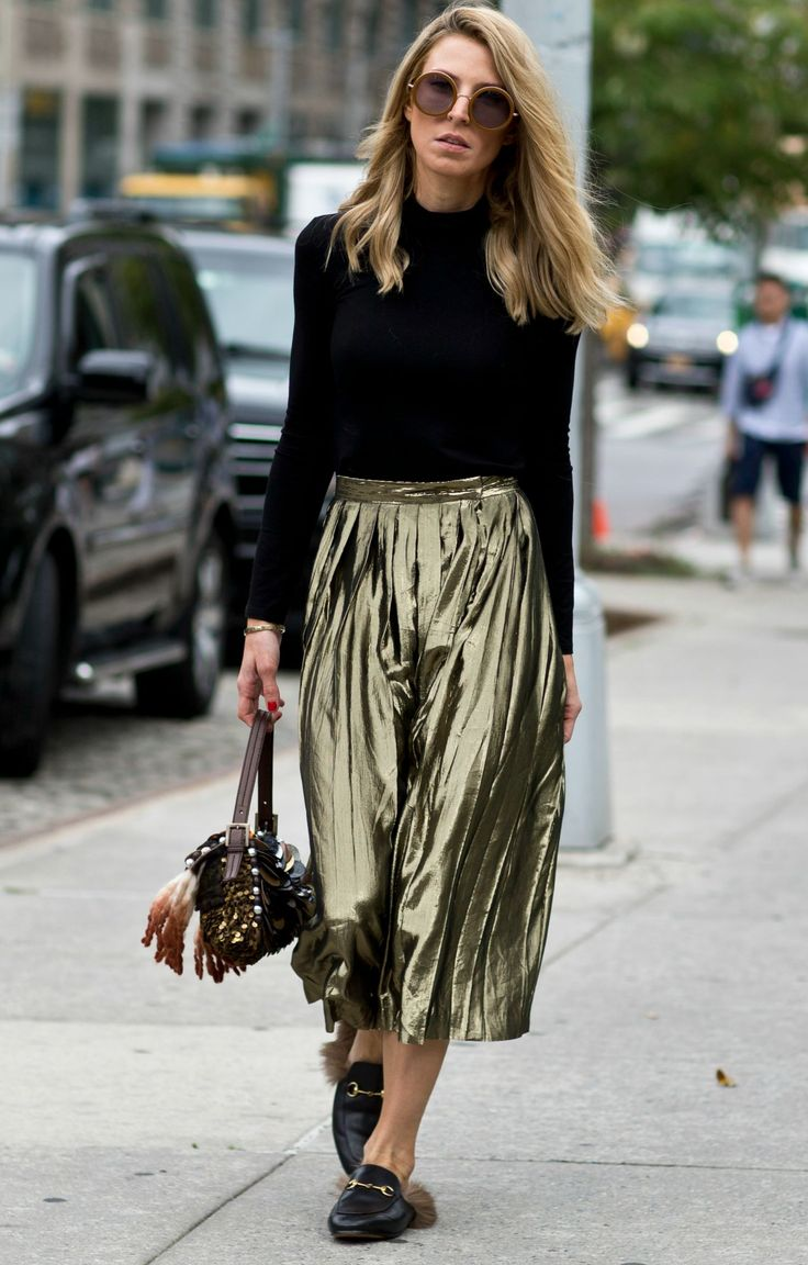 Must See New York Fashion Week Street Style, Fall 2015 - Pleated olive green metallic midi skirt styled with a black turtleneck and round sunglasses: