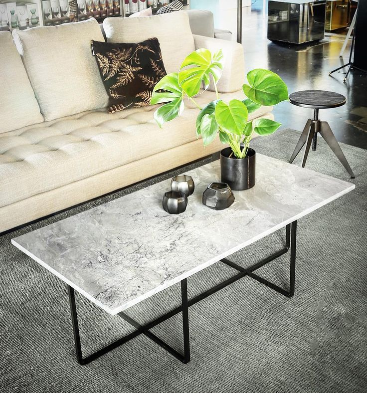 Out Ninety coffee table with white marble top and black powder coated frame,