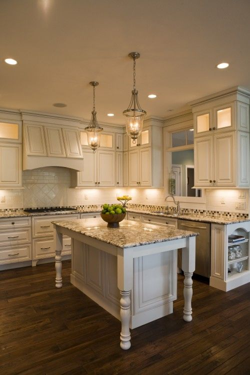 White cabinets with granite