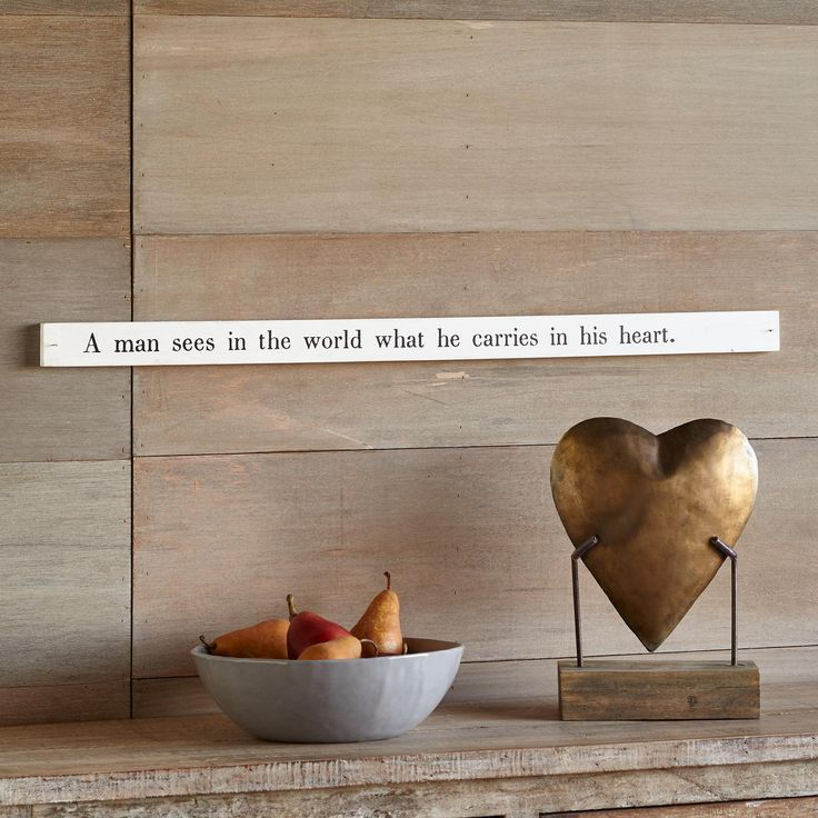 """WORLD POETRY STICK--Invite poetry into your life everyday with this inspirational, painted pine board that touts Johann Goethe's quote, """"A man sees in the world what he carries in his heart."""" Hang on the wall, prop on a shelf. Imported. 3/4""""W x 30""""L x 2""""H."""