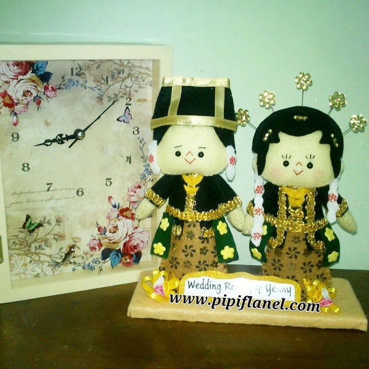 Hi, this cute feltdoll is wearing Java traditional wedding costume, made by Pipi Flanel.. Wanna see our feltdolls collection? Please visit our website at www.pipiflanel.com thank you :)
