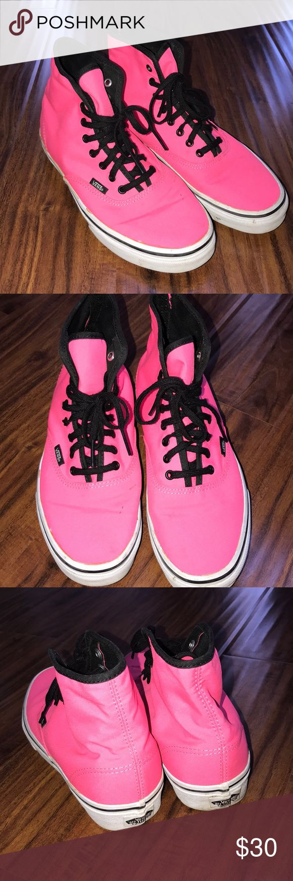 High Top Hot Pink Vans In great preowned condition.  Only worn a couple of times.  There are a few spots on front that can be spot cleaned.  See all photos.  Size men 7, worn 8.5 Vans Shoes Sneakers