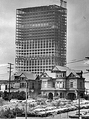 Juxtaposition of old and new right before old was destroyed: Downtown LA - The Union Bank Square building takes shape above Bunker Hill Victorians in a 1966 photo.