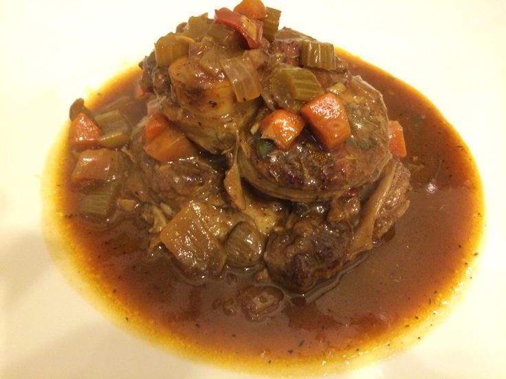 Veal Osso Bucco served with a garnish if Gremolata - winter warming food