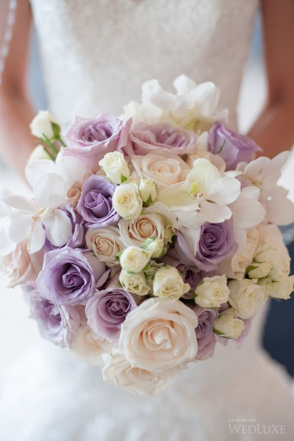 Erika+ Michael | Lovely Lilac Wedding | The bride carried a beautiful bouquet with subtle touches of the day's palette—lilac roses—while wearing a gorgeous lace covered gown.