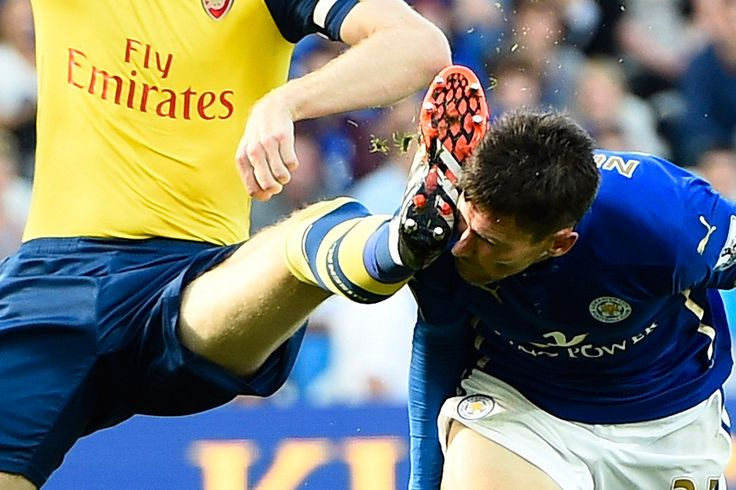 Arsenal's Per Mertesacker catches Leicester City's David Nugent in the face during their Premier League match at the King Power Stadium in Leicester, England