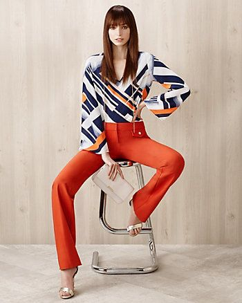 The big orange and blue stripes make the top more active. It's like the shirt you can wear for work , or dating.