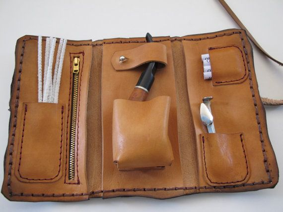 Handstitched leather pipe pouch with handmade print using pyrography technique. It has one pocket for the pipe, four for the tools and an extra one