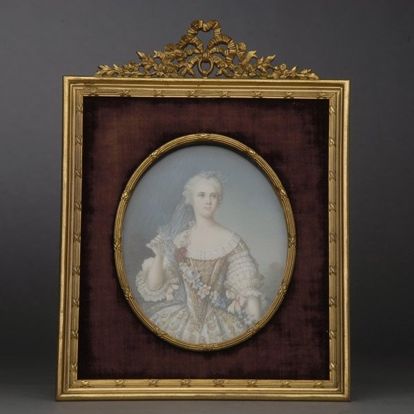 "French Miniature Portrait of Sophie de France. TheÊhalf length portrait of a young lady, wearing an elaborate court dress with gilt embroidery and a floral garland sash, her hair powdered, reserved against a blue atmospheric sky with trees in the background foliage, signed ""Rocize"" vertically in lower right corner of the plaque, mounted in an Empire style gilt bronze frame with a ribbon tied trophy and purple velvet ground border, stamped B. Altman & Co. After Jean Marc Nattier, Circa 1900…"