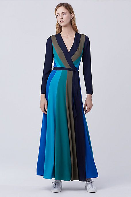 Clever colorblocking and a subtle stretch silk adds movement to this sophisticated wrap dress.
