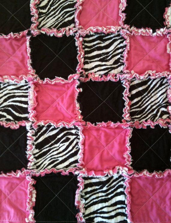 Hey, I found this really awesome Etsy listing at http://www.etsy.com/listing/90399774/zebra-and-bright-pink-rag-quilt-with-dot