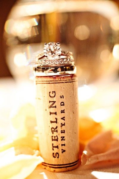 love this wedding rings and wine cork shot!