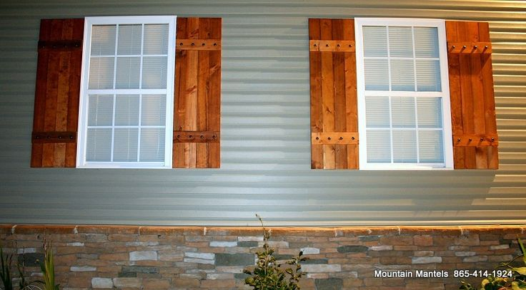 wood board and batten stained shutters with metal bolts covington