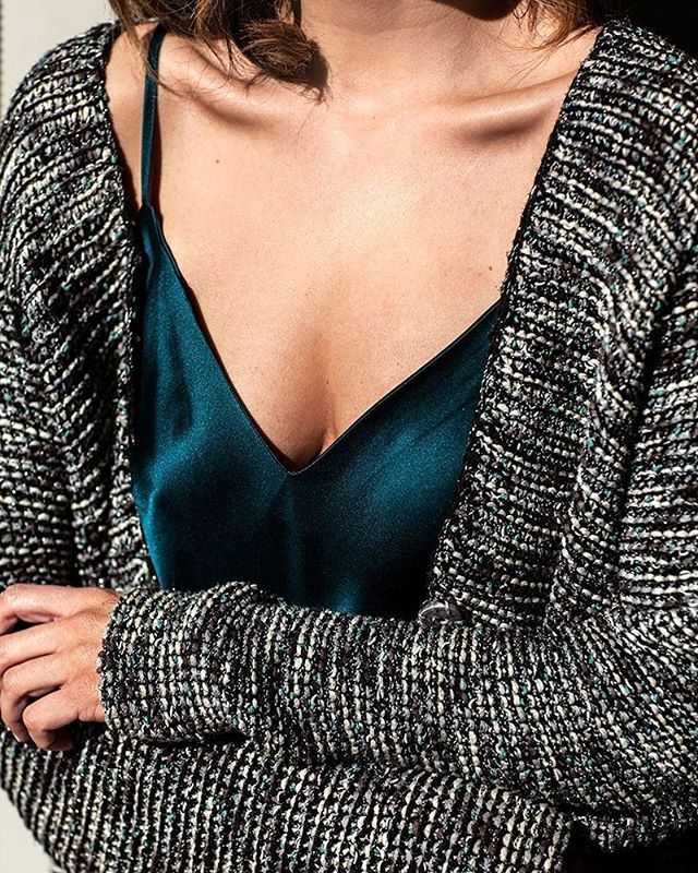 Our Eva Silk Cami is a versatile wardrobe staple on its own, or wear with a cozy knit for those balmy Spring days. Available in emerald, nude & navy, shop it online now. #natalijastyle