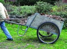 A garden cart is not a wheelbarrow. Instead of having a single, squat tire, a garden cart has a large body boxed in by wood, sometimes aluminum, flanked by two, heavy-duty, bicycle-size tires. The tires' size and the fact that they're centered along the wooden bed make a garden cart usef...