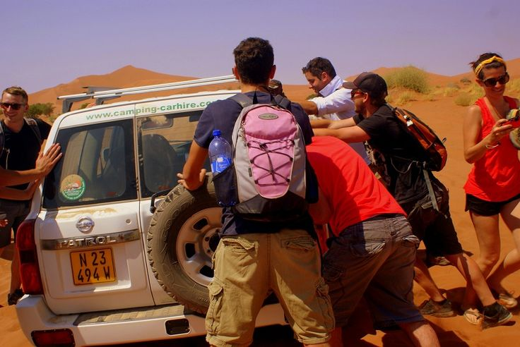 The desert swallows cars WHOLE.  Trying to get the truck out of the sand so we can continue on our way.  #Africa #Namibia