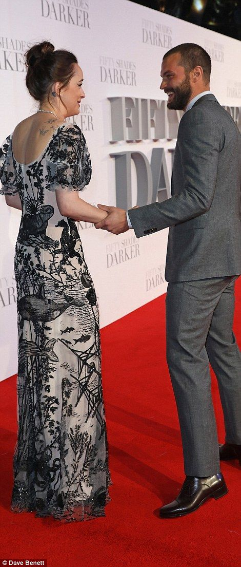 Hugging it out: Dakota and Jamie shared a warm embrace when they first met at the star-studded film event