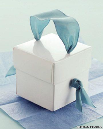 This is so cute- hole punch plus ribbon! Dressing Up the Basic Box - Martha Stewart