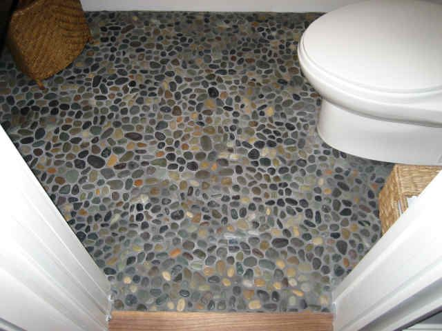 Pebbles look beautiful when they are wet. Would love a real pebble floor in a wet room/bathroom