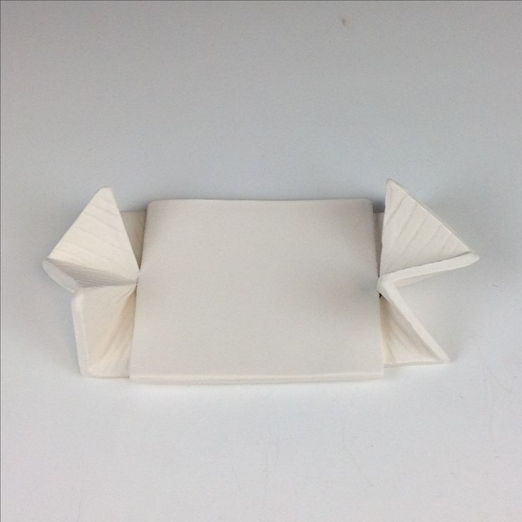 My little tray built with leather hard slabs and triangles    https://artroom14.wordpress.com/student-galleries/emma/