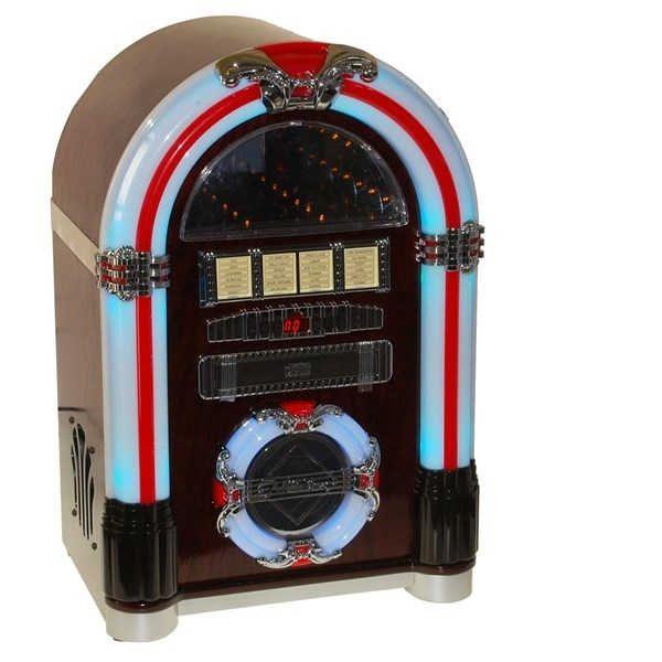 ¿ siempre has soñado con tener tu Jukebox? esta es tu oportunidad. Mando a distancia, lector de CD, radio AM/FM, altavoces stereo, salida externa para  conectar otros equipos de sonido, entrada auxiliar para conectar audio (Jack mini) Puerto, LECTOR/GRABADOR de USB y tarjetas SD, y luces LED en colores que cambian en toda la máquina ....más??? pues esta belleza hipercompleta se reduce al mínimo espacio, 48 x32x25 cm, para que puedas colocarlo en cualquier parte. Vas a resistirte?…
