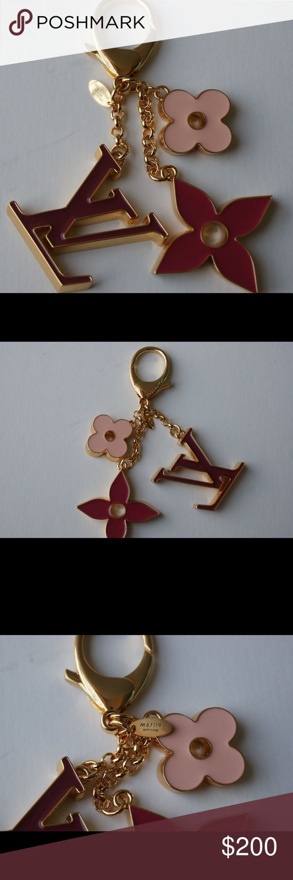 LV bag charm and key holder.LK67119 Elegant enamel is one of the hallmarks of the Fleur de Monogram Bag Charm. Its timeless celebration of the classic Monogram design is another, making it an easy match for any iconic bag of the House. Louis Vuitton Other