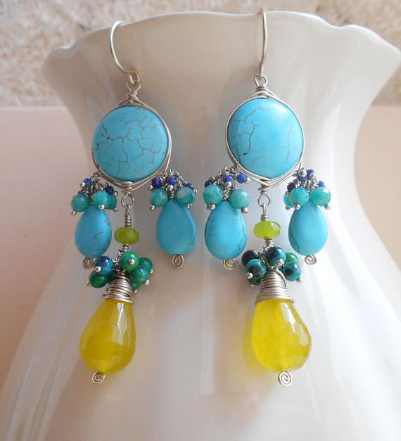With a bright, vibrant and mood lifting color story, Sunshine gemstone chandelier earrings pretty much make an entire outfit come alive! The focal element is a saturated turquoise color howlite smooth coin bead, which I wire wrapped with sterling silver wire using the herringbone