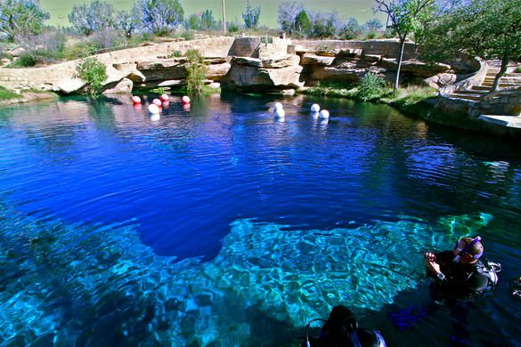 SANTA ROSA, NEW MEXICO  Santa Rosa Blue Hole A clear blue swimming hole that has hidden unexplored caves for over 40 years