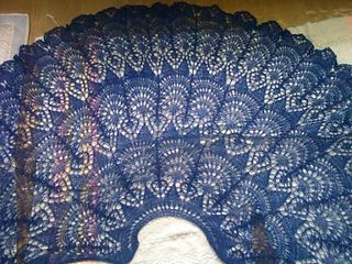 Based on the Stor Rund Dug doily with significant alterations. I used about 500 yards of stranded baby alpaca and baby mohair, laceweight.