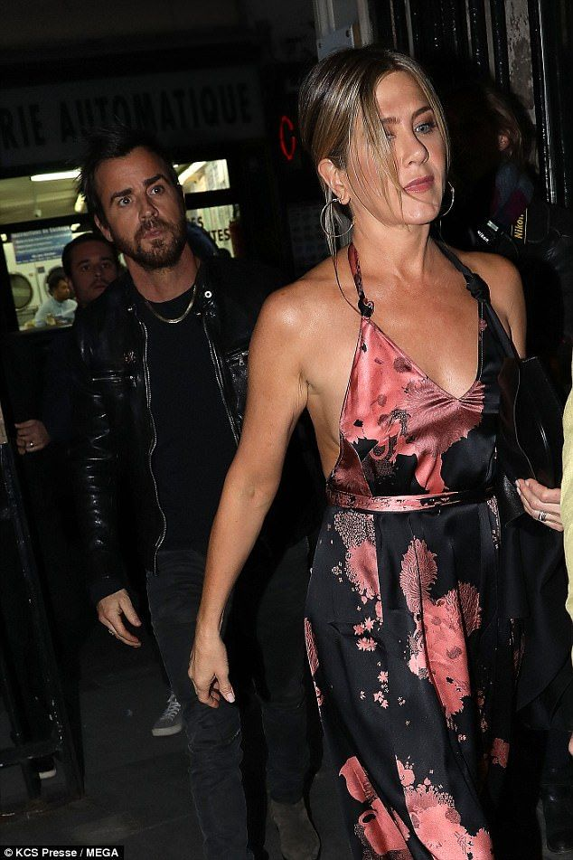 Jennifer Aniston cut a stylish figure in a maxi dress Wednesday night as she headed out to dinner with her husband Justin Theroux on their Parisian trip. They'd chosen Verjus on the Rue de Richelieu.