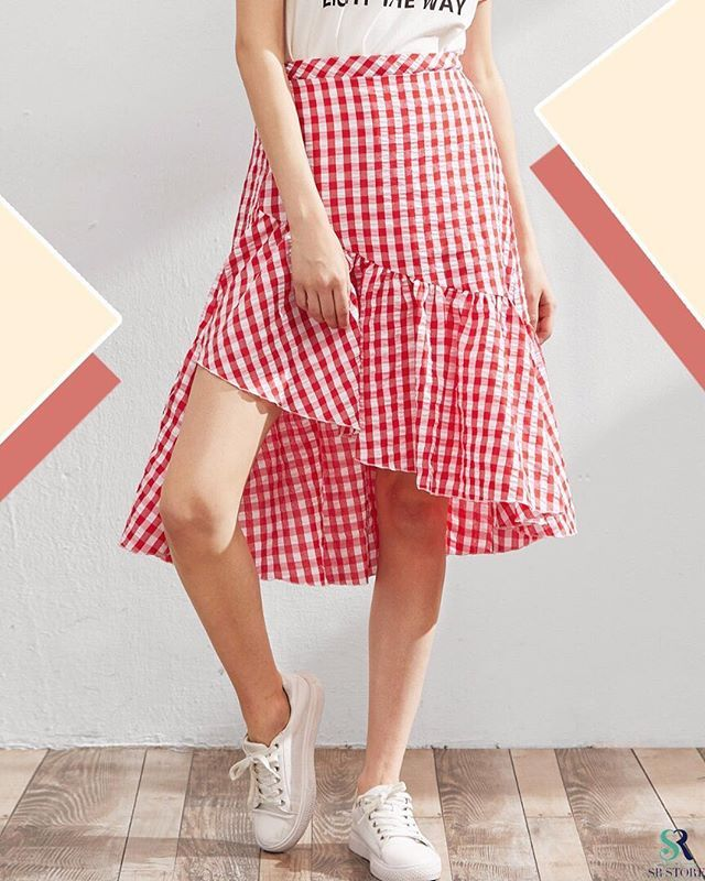 Get going in gingham this season with a frilly skirt and plain tank top. #instastyle #ginham#trend #checks #ginghamskirt #red #white #frill #skirt #outfitinspo #srstore Gingham Asymmetric Frill Skirt. Price 1299/-