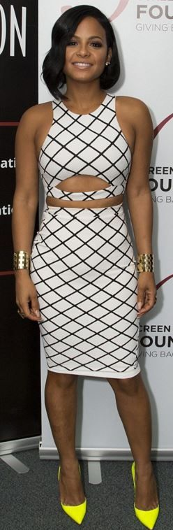 Who made Christina Milian's white print skirt and black print cut out top?