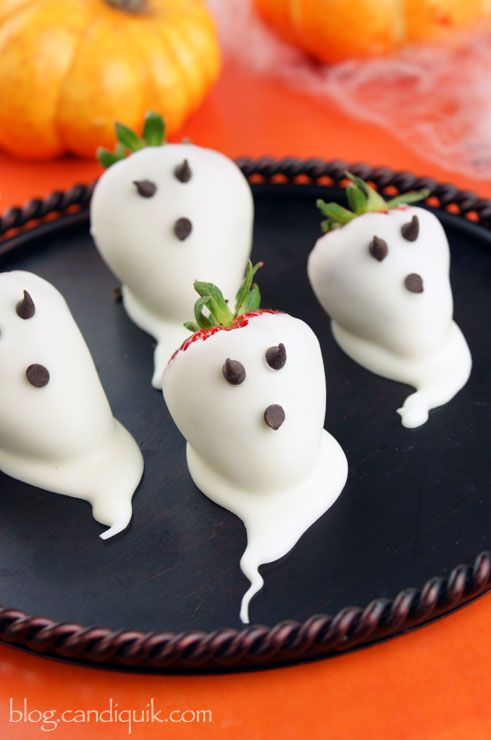"Strawberry Ghosts -- are these cute! Love the little ghost ""tails"" on them #halloween #partyfood"