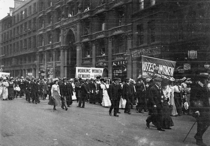 Circa 1900: Male and female members of the women's suffrage movement on a protest march through London. | 28 Powerful Pictures Of Women Fighting For Their Right To Vote